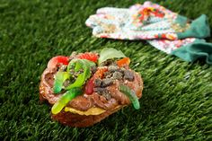 Earthwich: Pumpernickel bread with Smooth Operator and Dark Chocolate Dreams peanut butter and apricot jam, topped with cookie crumbs and gummy worms.
