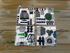 Moderne sierpotten gemaakt van Marimekko weefsel warme pads