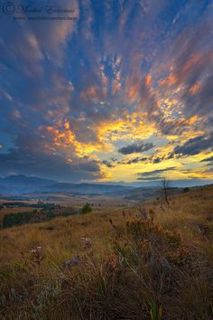 Fire in a Berg Sky - A flaming sunset over the Drakensberg mountain range, South Africa. The Ukhahlamba-Drakensberg Reserve is a UNESCO World Heritage site.