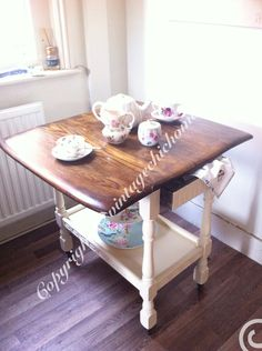 Stunning #vintage shabby chic tea trolley with waxed dark oak drop leaf top and painted cream farrow and ball legs and shelf . Cute little draw for napkins or cutlery idea, for a tea party #teaparty #paintedfurniture