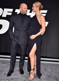 So happy: On Saturday, the 29-year-old pregnant star wowed in a black off-the-shoulder dre...