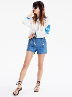 madewell embroidered tassel top worn with denim shorts + sunglasses. call 866-544-1937 or email shopfirst@madewell.com to pre-order.