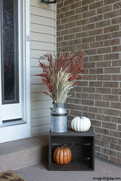 Fall Porch Decor Ideas - A Cup Full of Sass Fall Front Porch Decor. An easy way to decorate for Fall with galvanized milk can, fall foliage and simple pumpkins in a black crate.