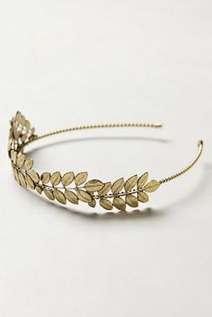 Gold Headband - This gold plated headband shaped as a leafy crown is subtle enough to be worn for any occasion. Buy them for your bridesmaids as a gift they can wear for the big day and beyond.