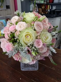 Gorgeous bridal bouquet in soft pastels with swirl roses! Photos do not do it justice! X