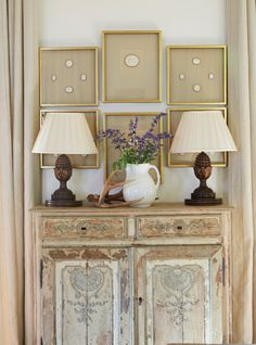Charming vignette with antique painted chest & framed intaglios