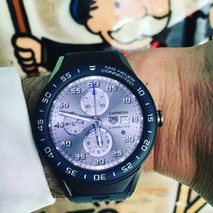 Rocking a customized #carrera face on the @tagheuer #connectedwatch at the brand's #bmc press event in L.A. In the background: artwork by guest of honor and #tagheuer partner @alecmonopolyart. #watches #watchesofinstagram #graffitiart #ElectronicsStore