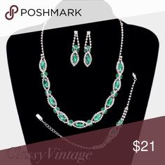 "Gorgeous 3 piece marquise set Marquise cut crystals with rhinestones outlining them. Necklace is 16"" with a 3"" extender. Bracelet is 7"" with a 2"" extender. Earrings are pierced and 2"" long. Stunning emerald green. boutique Jewelry Necklaces"