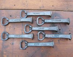7 Personalized Groomsmen Gifts, Railroad Spike Bottle Openers. Hand Forged by Blacksmith Gerald Boggs
