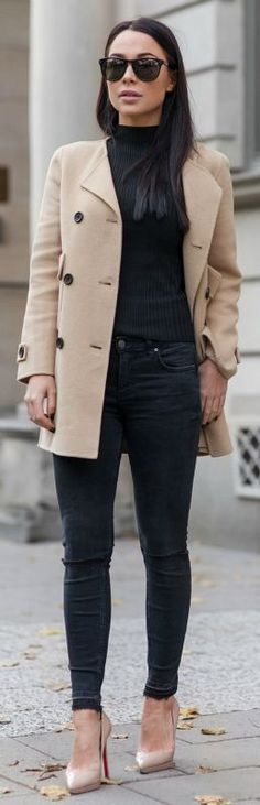 Black and camel outfits are in the height of fashion at the moment. Johanna Olsson is wearing the trend through black jeans, a black polo neck tee, and a classic camel coat. We recommend this look for a casual style.   Brands Not Specified....   Style Inspiration
