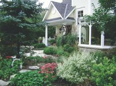 The perfect partner for a charming cottage is a colorful and oh-so-delightful landscape.