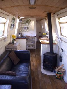 Nice living room (shame about the leather settee.) like the log burner narrowboat Yacht Design, Tiny Living, Living Spaces, Living Area, Living Rooms, Canal Boat Interior, Narrowboat Interiors, Narrowboat Kitchen, Houseboat Living