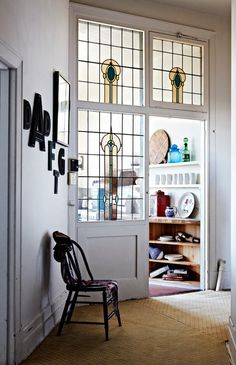 I love the stain glass partition.  You could replace a wall in a home (or add one) and add functionality, beauty, & charm all in one.  Very cool.