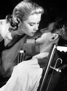 Grace Kelly and James Stewart in Rear Window (Hitchcock, 1954). BTW, Martin Scorcese loves this scene.