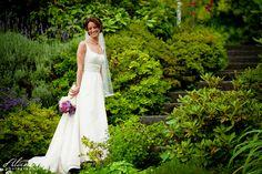 delille wedding venue | Bride in the garden at DeLille Cellars