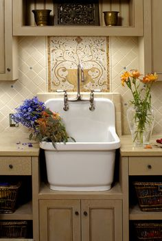 This utility sink is such a pretty alternative to the ugly plastic ones.