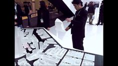 Constructed for CES International 2014, the Audi Urban Future Initiative Interactive Table displays the results of the City Dossier Boston project as well as projections for the future of urbanism. The table utilizes augmented reality screens which layer these projections onto a model of the city of Boston to contextualize data and visions.