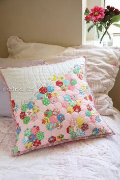 Minki Kim of #MinkisWorkTable created this lovely cushion that looks like lots of little pieced hexagons, but it is in fact a hexagon cheater print! Of course she worked in some of her signature sewing illustration. For her quilting and stitching, Minki used our Aurifil 28wt, 50wt, and soon to be released 80wt thread! Want to make your own version of this cushion? Head over to the Bernina USA #WeAllSew blog for a full tutorial!