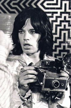Young Mick w/ polaroid.