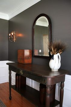 Dining room with white moldings. Paint color is Mined Coal by Behr in an eggshell finish.