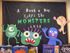 Halloween library display with different monster book characters - A Book a Day Keeps the Monsters Away