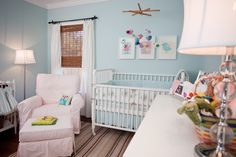 A pale aqua birds room for a little girl, though definitely gender neutral.