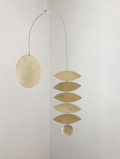 Brass kinetic sculpture featuring hand cut shapes from brass sheet + chain. Suspend from the ceiling from a hook or hang as a wall piece with a nail. Handmade in California. Dimensions: x Kinetic Toys, Kinetic Art, Mobile Sculpture, Sculpture Clay, Hanging Mobile, Diy Hanging, Hanging Decorations, Mobiles Art, Diy Clay
