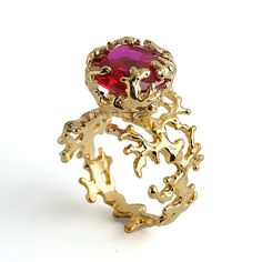 The unique CORAL Ring with a Ruby gemstone is part of a collection inspired by the living sculptures of corals. The large synthetic (lab created)