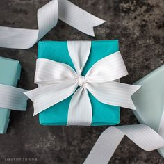 To tie a Tiffany bow, you will wrap the ribbon in both directions on the box. This allows the ribbon to sit flat on the bottom - no crossed knots will...