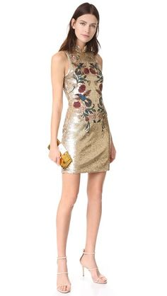 Mirrored sequins and jewel-tone embroidery bring glamorous style to this Parker mini dress. Flirty back cutout and mandarin collar. Button closures and exposed zip in back. Lined.