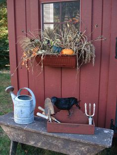 Enhance your garden shed by adding window boxes. You can change up your display according to the season. Add broom corn, bittersweet, gourds and pumpkins in the fall or fresh cut greens in the winter.