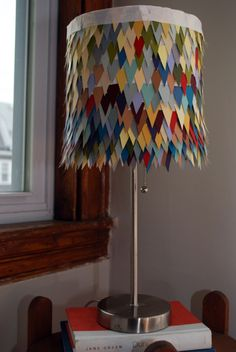 How to make a lampshade out of paint samples:    http://marieohmarie.com/2012/01/14/diy-paint-sample-lampshade/