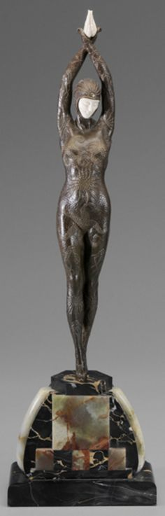Demeter H. Chiparus (Dimitri Chiparus, Romanian, French, 1886 to 1947), a bronze sculpture, Starfish bears signature D.H. Chiparus and Etling Paris, on marble and agate Art Deco style base.
