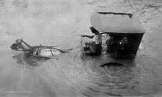 Carromata being driven in high water, Manila Philippines, 1910-1915