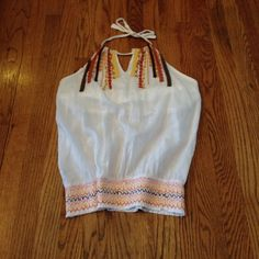 Bohemian Style Blowzy Tank top Boho style blowzy tank top w/  embrodery design at the chest. Ties at neck. Lined w/ cotton bra inside. Has embrodery trended at waist also. Gently Used. Very Cute Tank!! Prana Tops