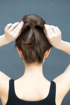 Take both hands to gently fan out the bun. Next, pin the ends of the ponytail into the base of the bun, leaving a few pieces out to look slightly undone if hair is on the shorter side.   - MarieClaire.com