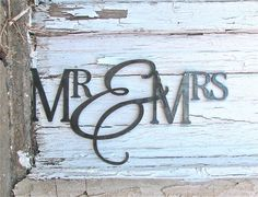 "Metal Wall Hanging ""Mr & Mrs"". $40.00, via Etsy."