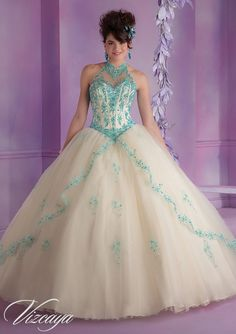 Quinceanera dresses by Vizcaya 89001 Tulle Quinceanera Dress with Embroidery and Beading Sweep Train. Matching Stole. Corset Tie Back. Colors Available: Champagne/Aqua, Royal, Stiletto, White. Sizes Available: 0-24.