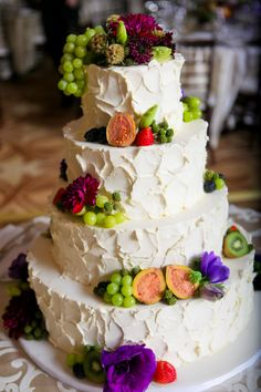 Love this unique cake decorated with fruit in addition to flowers!