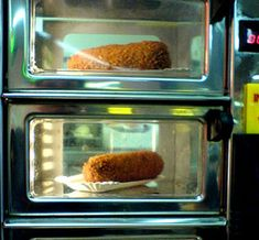 Dutch Fast Food in the WallEating 'kroketten' out of a vending machine wall. Typically Dutch
