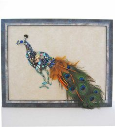 This fabulous Peacock, Aristocrat, is hand layered with real peacock feathers, vintage earrings, brooches, pearls, flowers, vintage rhinestone jewelry and modern jewelry. Absolutely stunning! This large custom framed Art Creation measures 24 x 19 inches. What a gorgeous one of a kind wall hanging for your home.  What Makes ArtCreationsByCJ stand apart from other jewelry art:  * HIGH QUALITY. Art Creations are NOT glued to a piece of fabric or velvet or some average store bought frame. They…