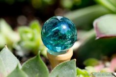 Another fairy gazing ball (see this marble gazing ball and other cute ideas for fairy homes via the link)