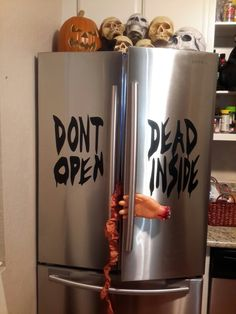 """Awesome shot of the Walking Dead inspired """"DON'T OPEN DEAD INSIDE"""" indoor removable vinyl applied on the Sticky Thingz fridge. And of course, a little decorating on the side just to give you some ideas. Available at our website at http://www.stickythingz.com #stickythingz #custom #decals #stickers #etsy #walkingdead #zombies #decoration #halloween"""