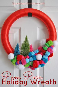Add some color to your home this Christmas with the most wonderful, colorful pom pom holiday wreath. See the simple tutorial at Sparkles of Sunshine today. Pom Pom Wreath, Diy Wreath, Wreath Ideas, Easter Bunny Decorations, Xmas Decorations, All Things Christmas, Christmas Crafts, Christmas Ideas, Craft Stick Crafts