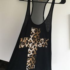 Sheer Back Tank Very cute and flowy. Leopard print cross on front. The back is all sheer, looks great with a colored bandeau. Worn several times but is in great shape! Cut the tag out because it was itchy, but is a large. Tmani Tops Tank Tops