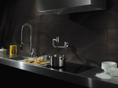 TARA ULTRA / Kitchen / Kitchen fitting / Dornbracht  TARA ULTRA is the modern interpretation of Tara Classic, specifically for the kitchen. The typical Tara spout geometry has been integrated into an independent design that is specific to the kitchen. The particularly tall, slender spout gives you great freedom to work with large pots and pans and other vessels. The ergonomically placed lever has a new and particularly striking design.