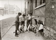Our Gang: Game of craps. Cincinnati, Ohio. August 1908. Back in the good old days when kids made their own low-tech fun. Photo by Lewis Wickes Hine.