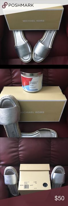Michael Kors Dempsey Metallic Leather Slides Last pair!!! Very comfortable metallic silver  espadrille slides . Round toe slip on that have never been worn. Size 7.5  box included. MICHAEL Michael Kors Shoes Espadrilles
