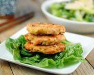Sesame Salmon Burgers by Elana Amsterdam: Quick, easy, and naturally gluten-free, these salmon burgers are nutritious and delicious.    Ingredients:   1 pound salmon, skin removed,   1 tablespoon toasted sesame oil,   1 tablespoon ume plum vinegar,   1 clove garlic, pressed,   1 teaspoon, peeled and minced fresh ginger,   ¼ cup chopped scallions, white and green parts only,   ¼ cup toasted sesame seeds,   2 large eggs,   Grapeseed oil, for frying.   Directions:   Rinse the...