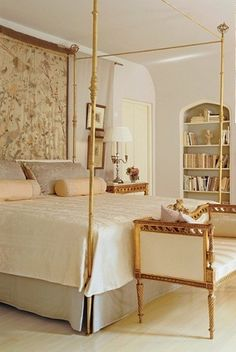 pretty, traditional bedroom with lots of gold accents; by José Solís Betancourt.